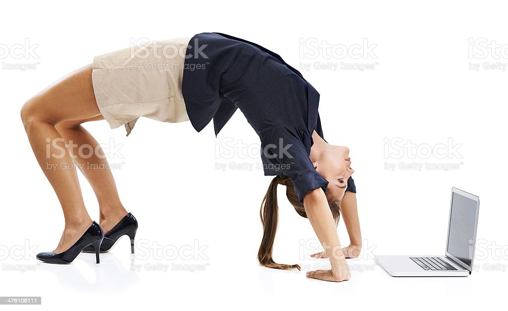 Bending over backwards for business stock photo
