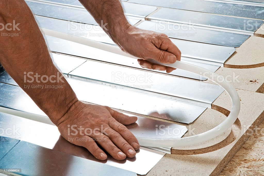 Bending plasting floor heating tube stock photo