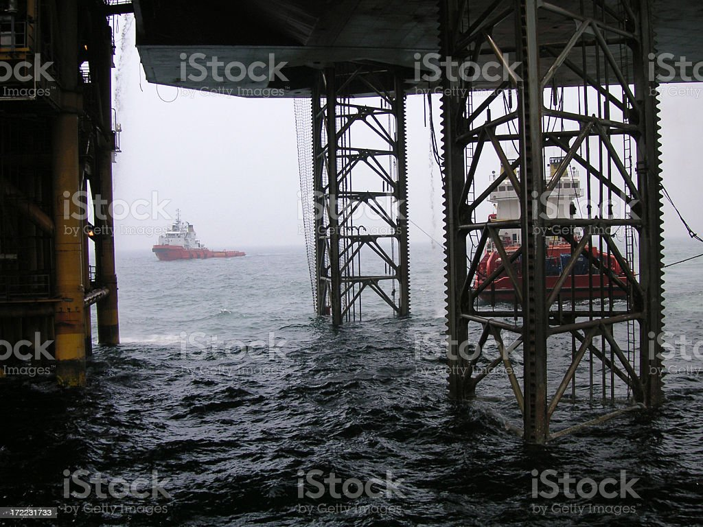 Beneath the rig stock photo