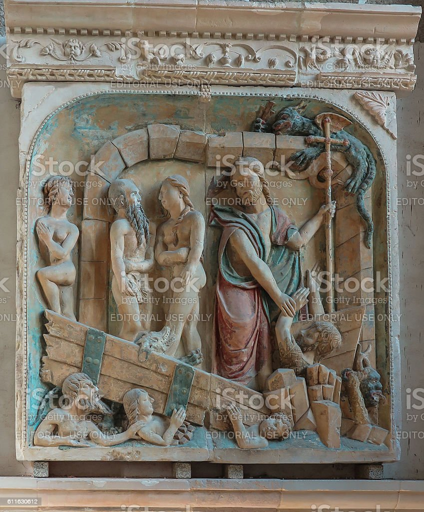 Benedictine Abbey of Mont Saint-Michel, Old bas-relief on the wall. stock photo
