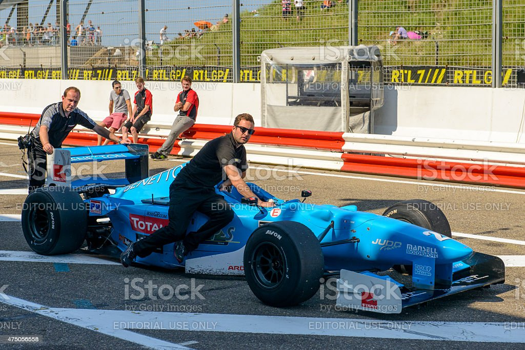 Benetton F1 car in the pit lane stock photo