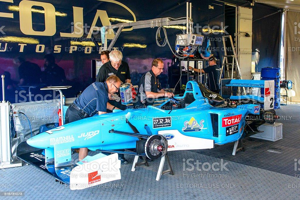 Benetton F1 race car in the paddock stock photo