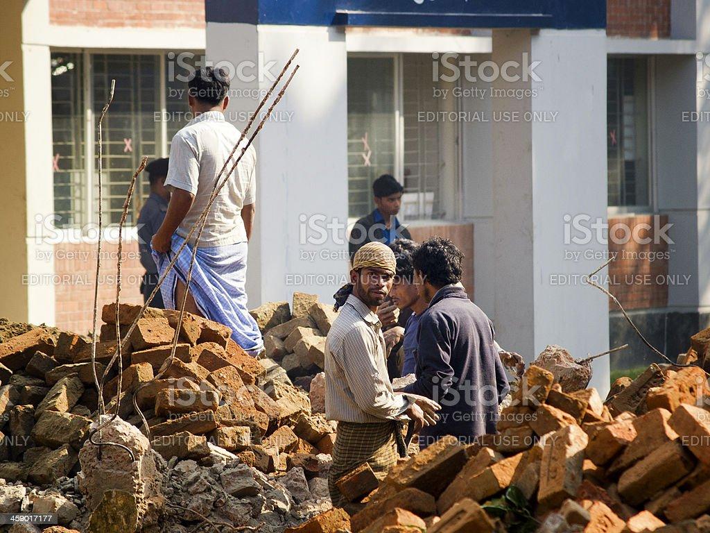 Bengali Labourers in poor working conditions stock photo