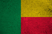 benin flag on an old grunge background