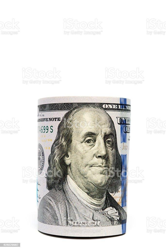 Benjamin Franklin detail on hundred-dollar bills stash isolated stock photo