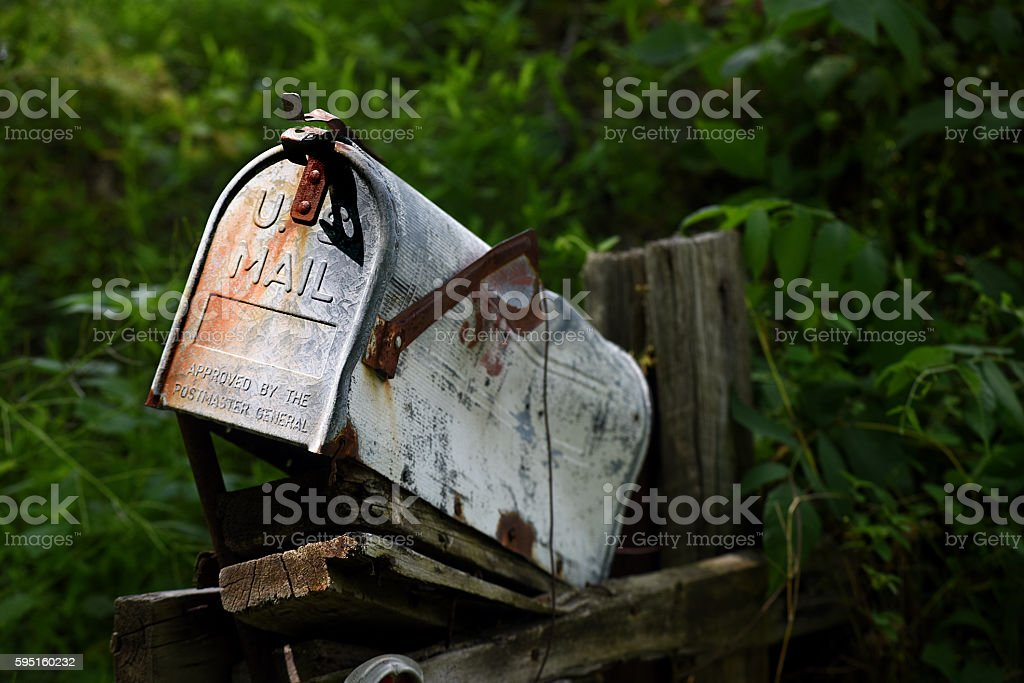 Bent and Rusted Old Mailbox stock photo