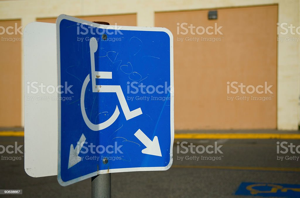 Bent and Vandalized Handicap Sign royalty-free stock photo