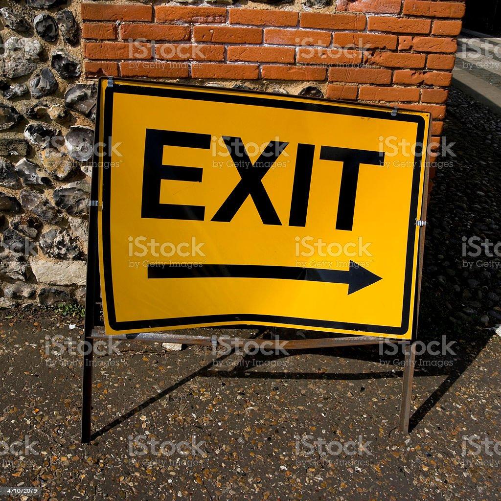Bent exit sign stock photo
