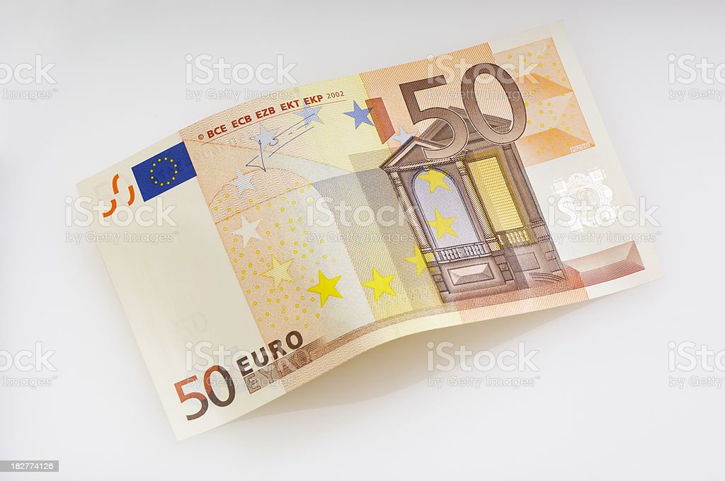 Bent fifty Euro banknote stock photo