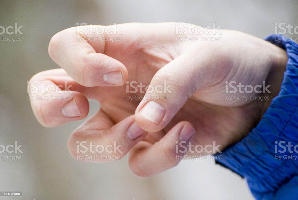 Bent fingers stock photo