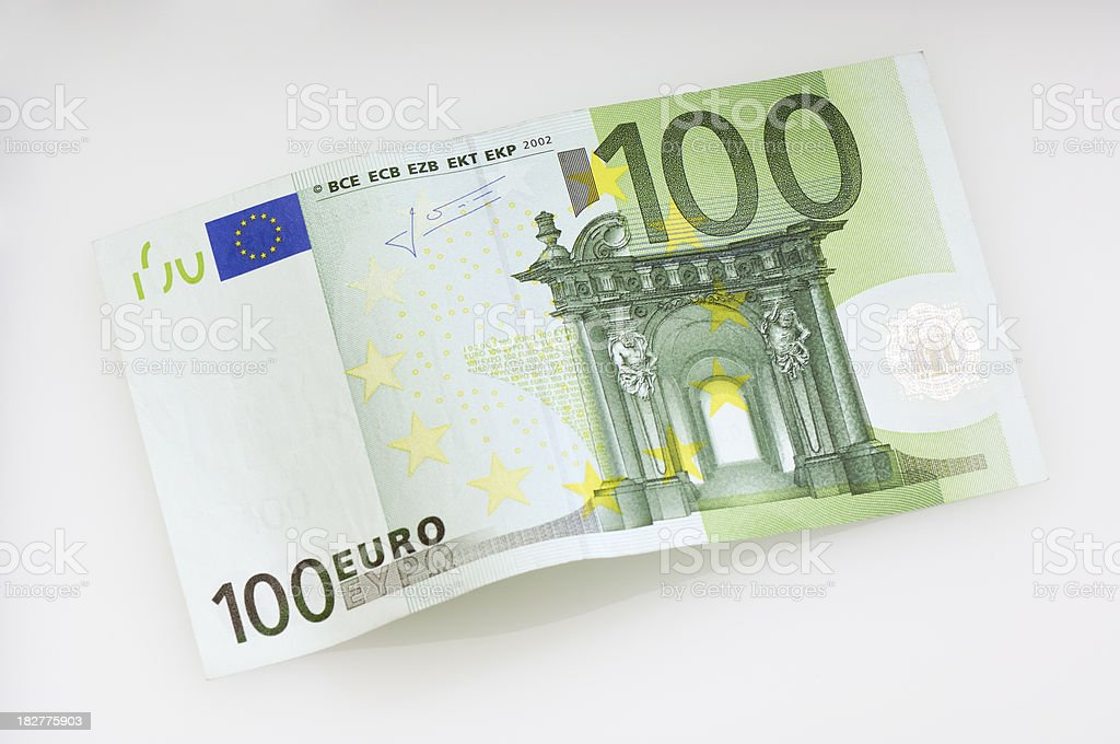 Bent one hundret Euro banknote stock photo