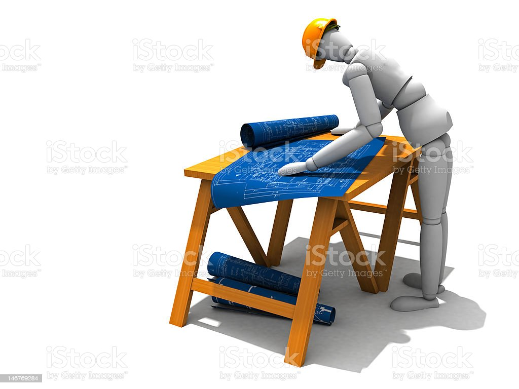 Bent over, reading the blueprints royalty-free stock photo