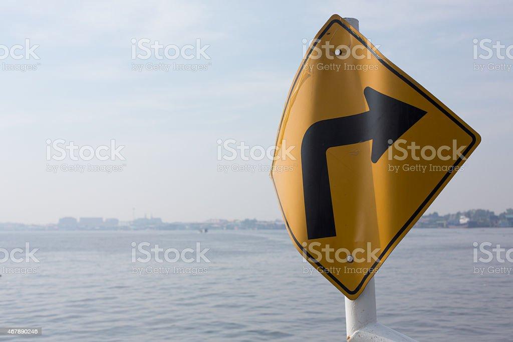 Bent right turn traffic sign, Tha Chalom, Thailand. stock photo