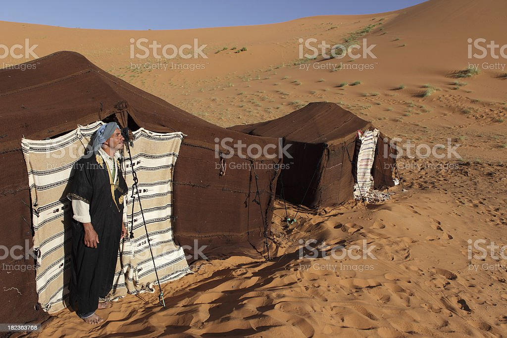 Berber and his Tents in Sahara Desert, Morocco stock photo