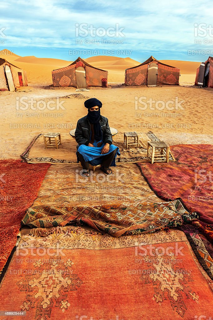 Berber guide sits in the camp in the Sahara Desert stock photo