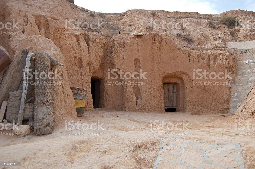 Berber home cut into a cliff face stock photo