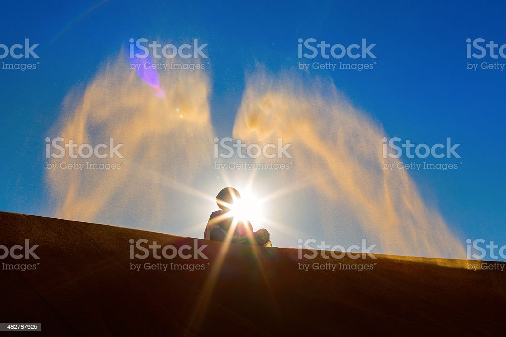 Berber playing and throwing with sands in Desert Sahara, creatin royalty-free stock photo