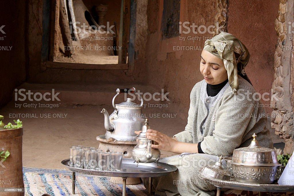 Berber woman prepares mint tea stock photo