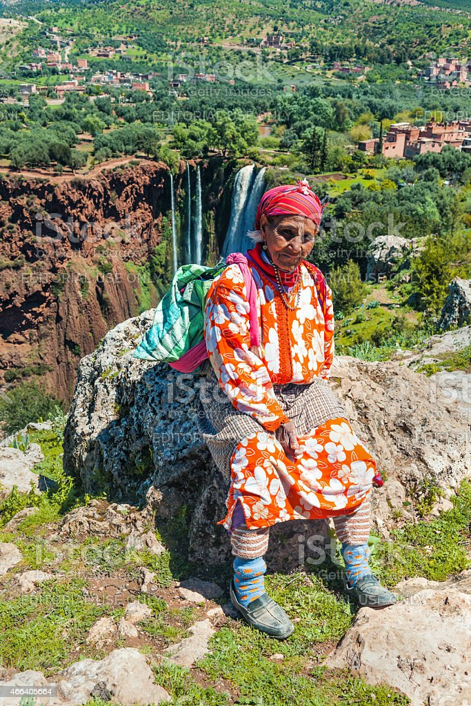 Berber woman resting on a stone,Cascades D'Ouzoud,Morocco Africa stock photo