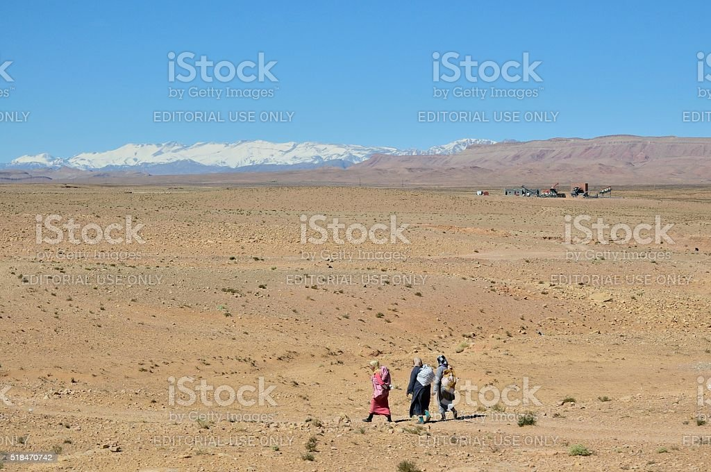 Berber Women Walking in Desert stock photo