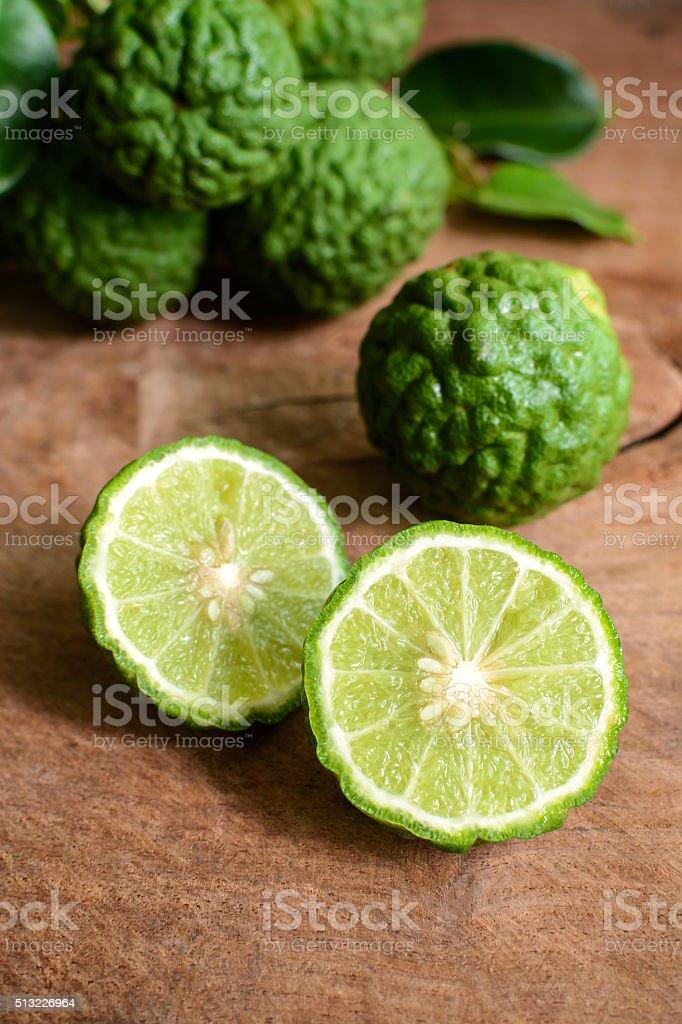 bergamot kaffir lime on wooden table stock photo