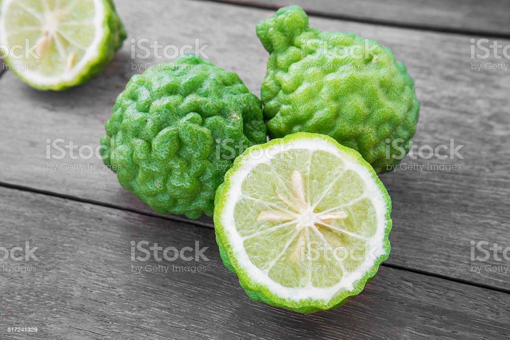 Bergamot on wooden background, (Kaffir lime) stock photo
