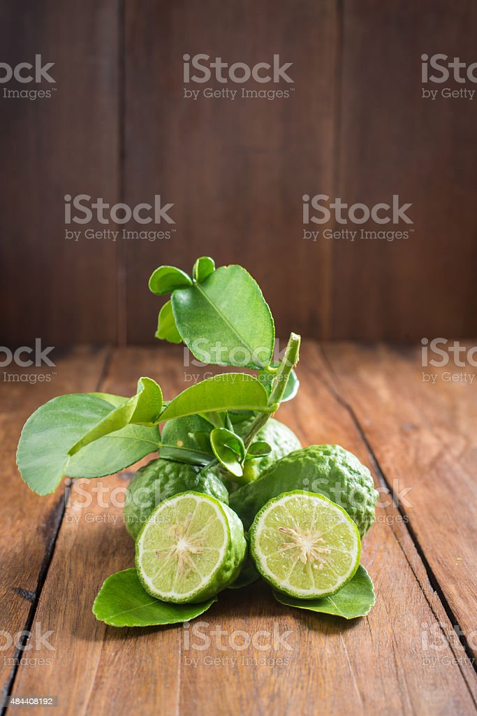 Bergamot with green leafs on wood background stock photo