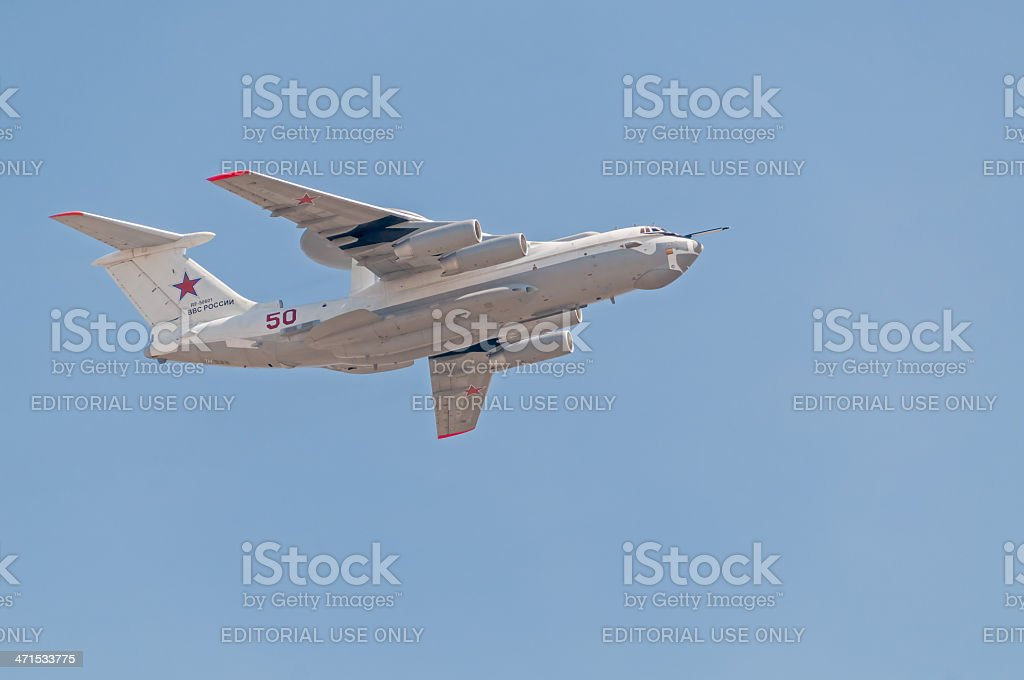 Beriev A-50 (Mainstay) AWACS aircraft flies against blue sky background royalty-free stock photo