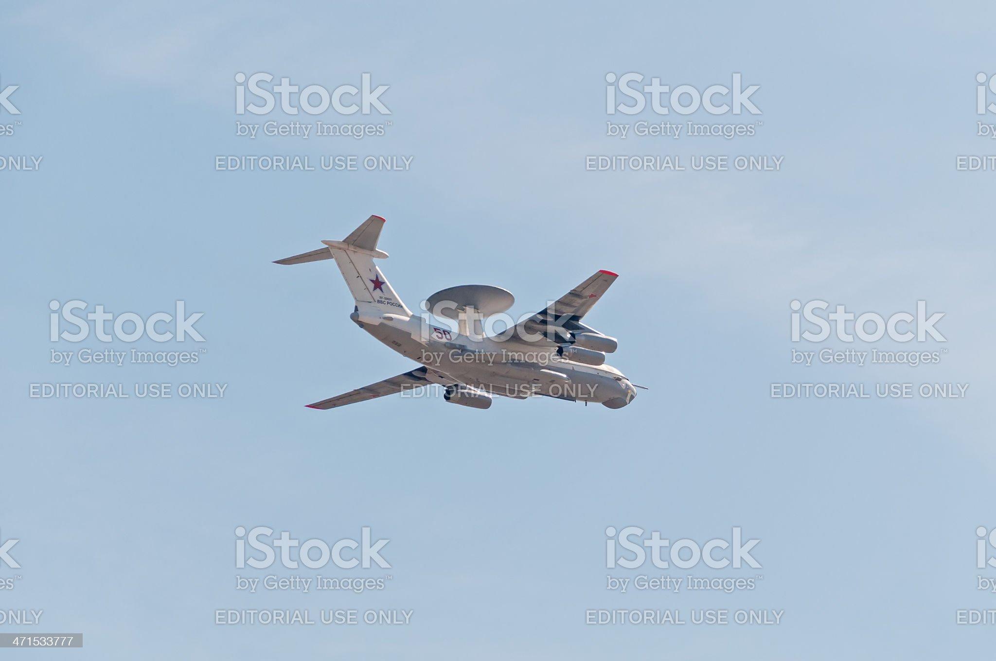 Beriev A-50 (Mainstay) AWACS aircraft flies against blue sky background royalty-free stock photo
