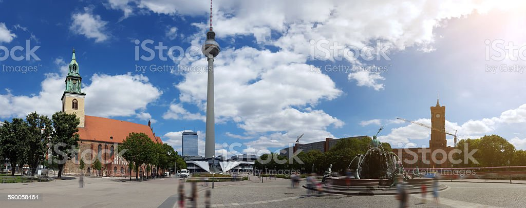Berlin Alexanderplatz Panorama - blurred people at Neptunbrunnen stock photo