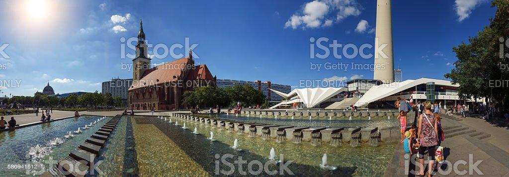 Berlin Alexanderplatz Panorama - people at fountains in summer stock photo