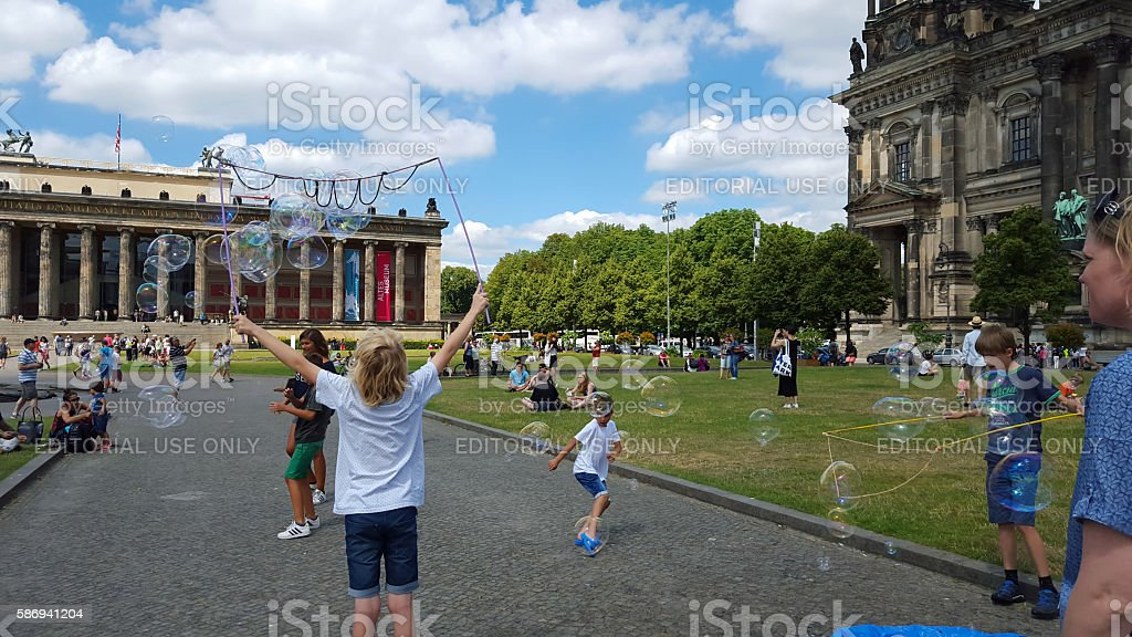 Berlin Cathedral and Museum - people on  meadow stock photo