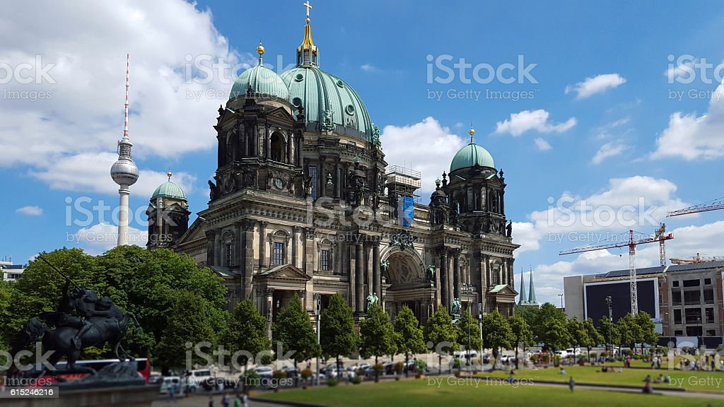 Berlin Cathedral and television tower - defocused people stock photo