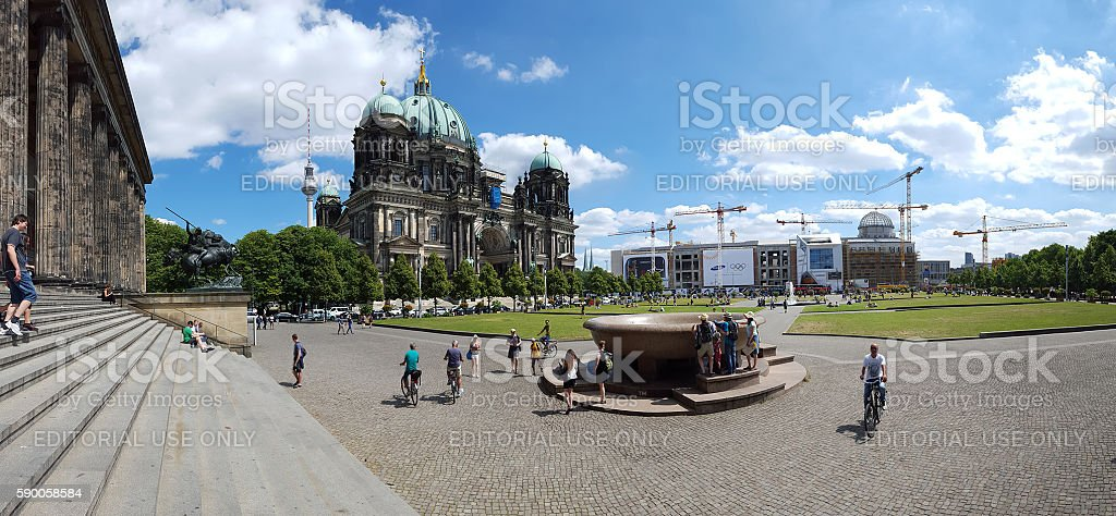 Berlin Cathedral and television tower - people on  meadow stock photo