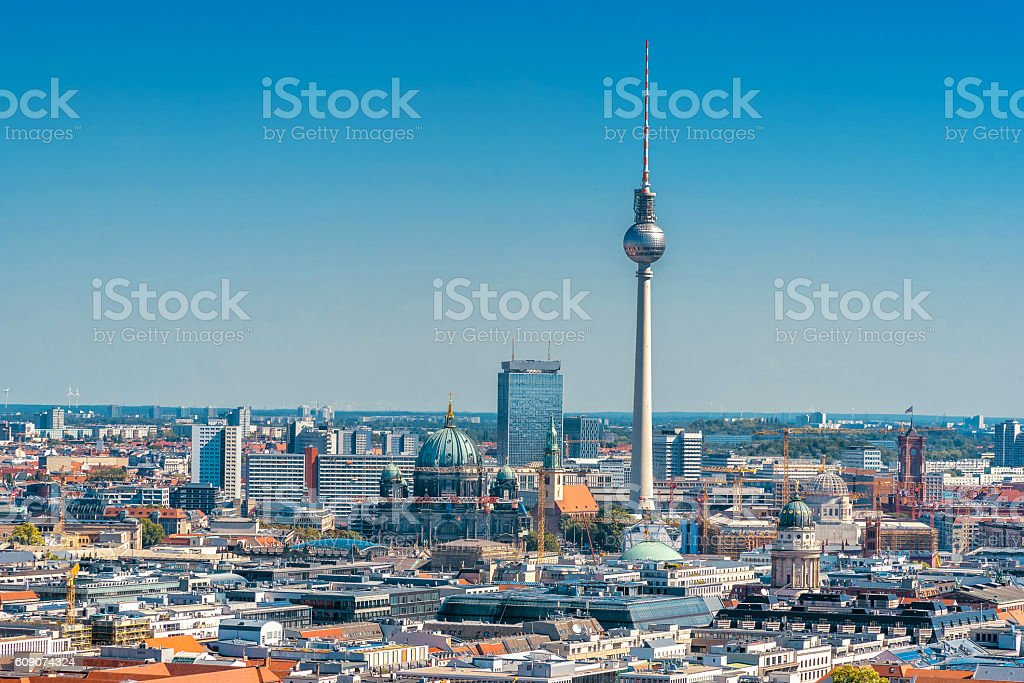 berlin cityscape with television tower and cathedral under blue sky stock photo