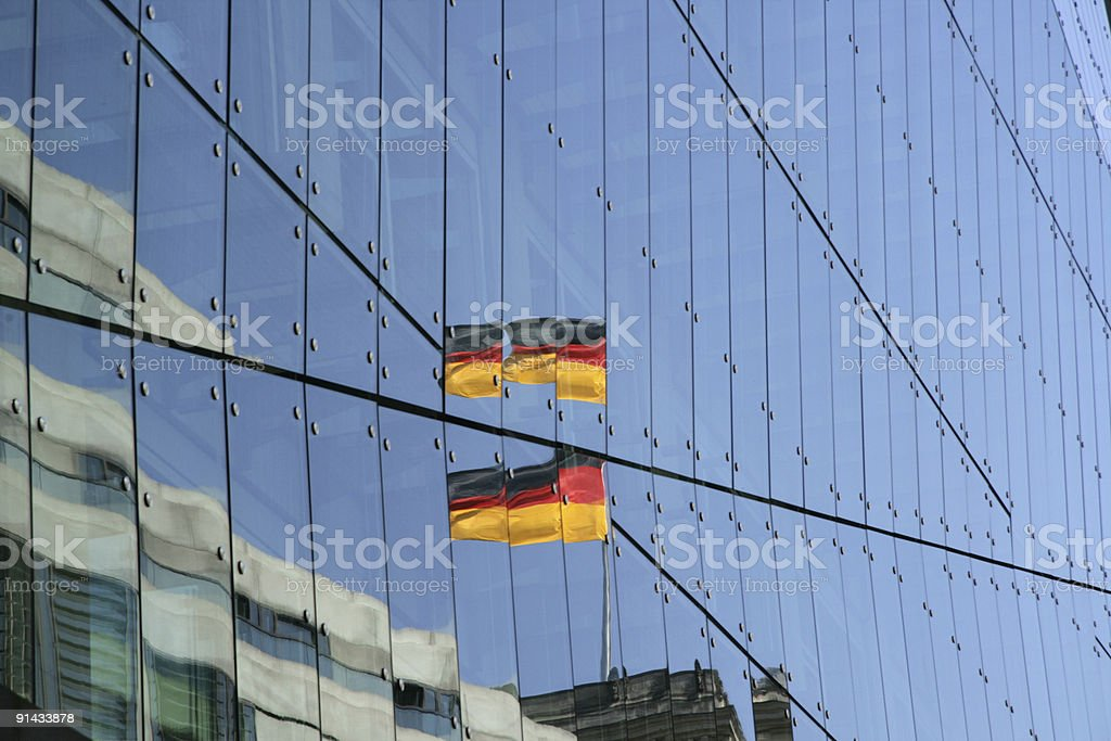 Berlin - German flag reflected in windows of new building stock photo