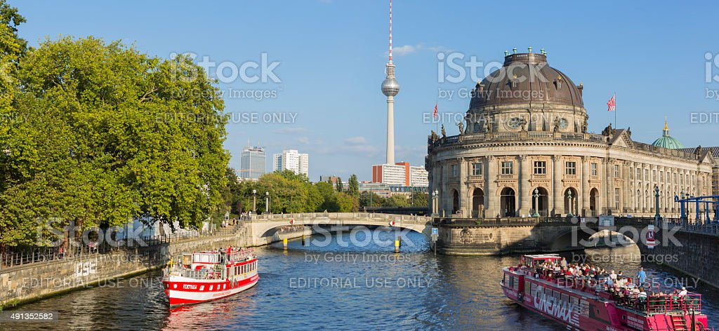 Berlin Germany tourist ships on Spree river near Bode Museum stock photo