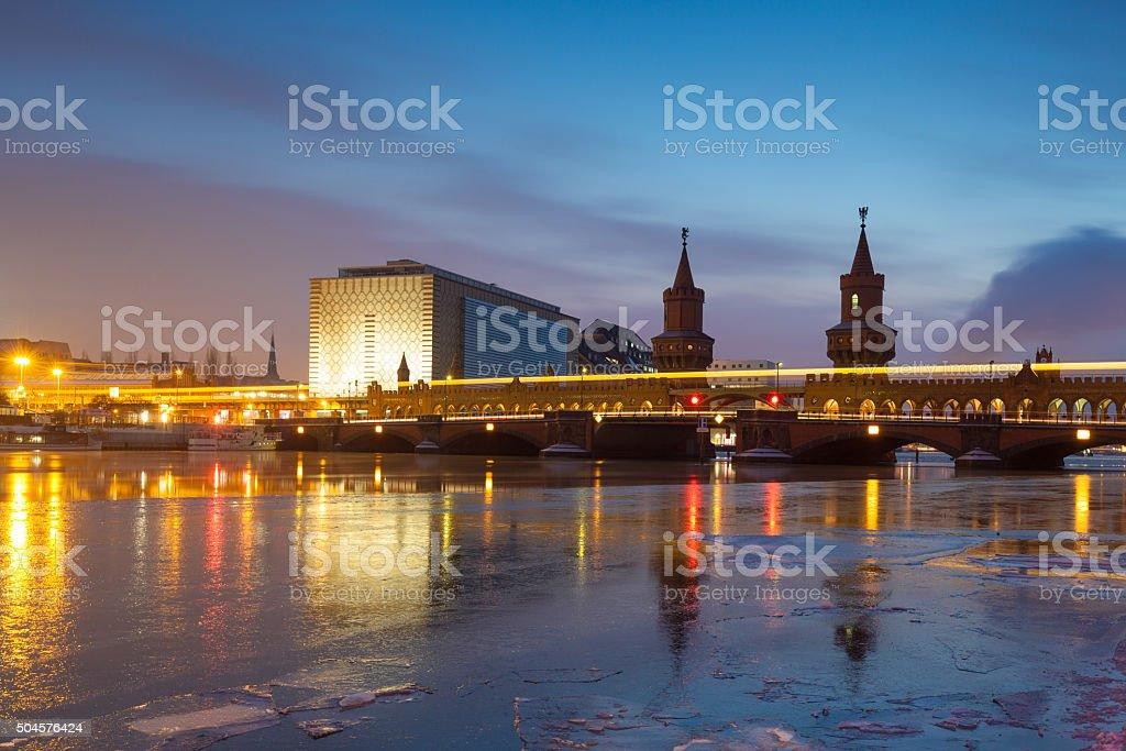 Berlin Oberbaumbrücke with frozen Spree river stock photo