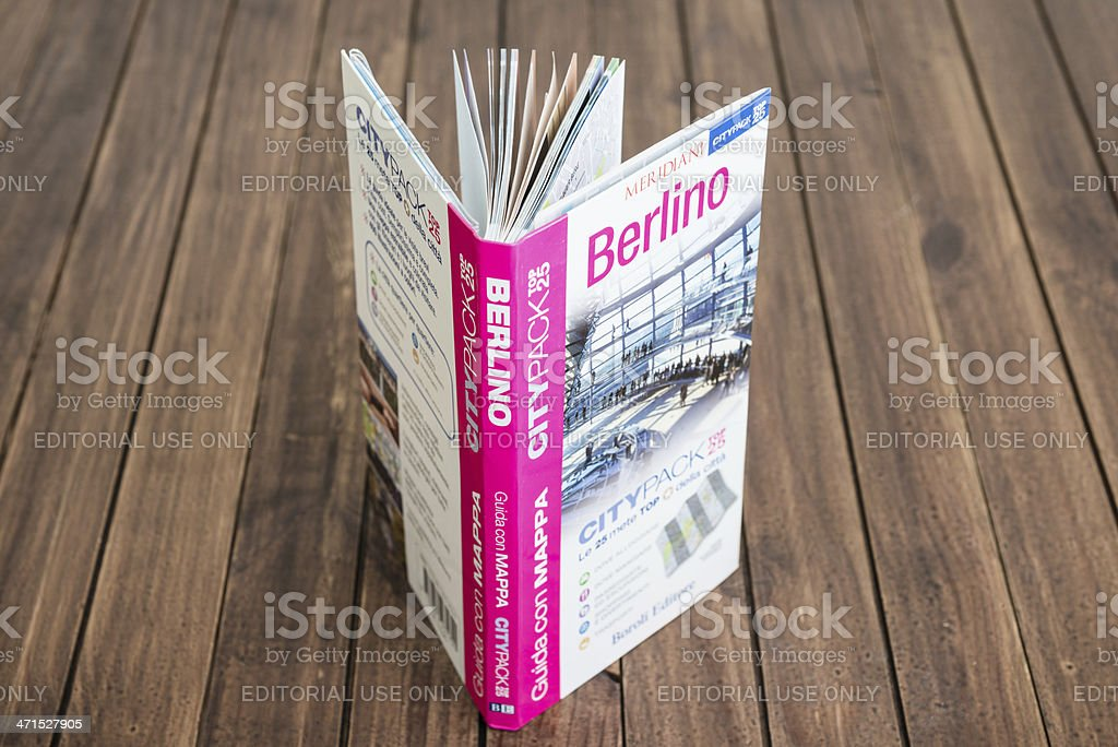 berlin travel guide books on the wood table royalty-free stock photo