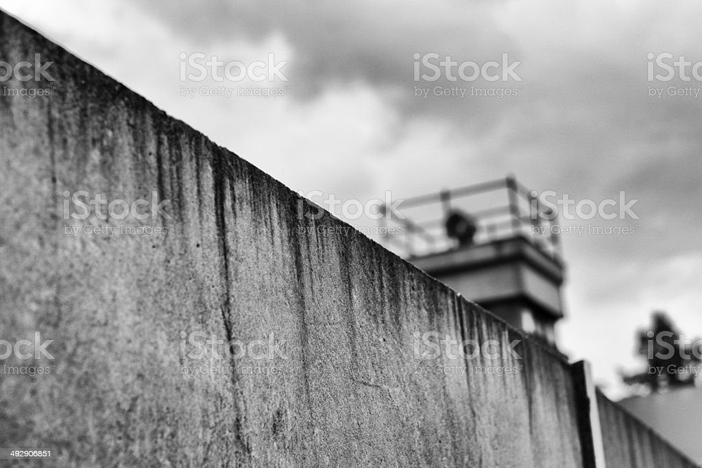 Berliner Mauer mit Wachturm / Berlin Wall and watchtower stock photo