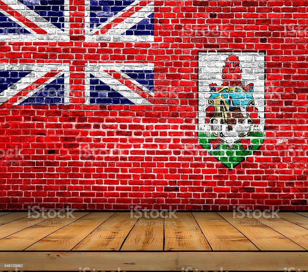 Bermuda flag painted on brick wall with wooden floor stock photo