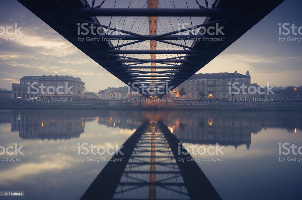 Bernatka footbridge over Vistula river in Krakow early morning stock photo
