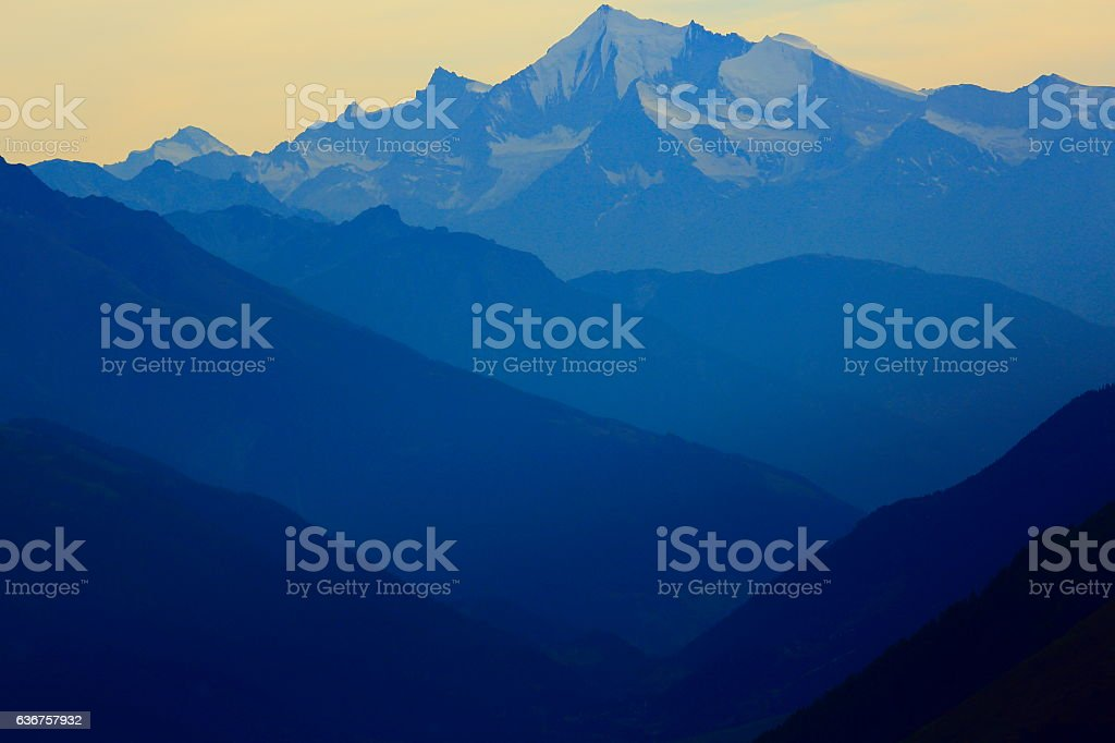 Bernese oberland mountain range summit silhouette, Swiss Alps stock photo
