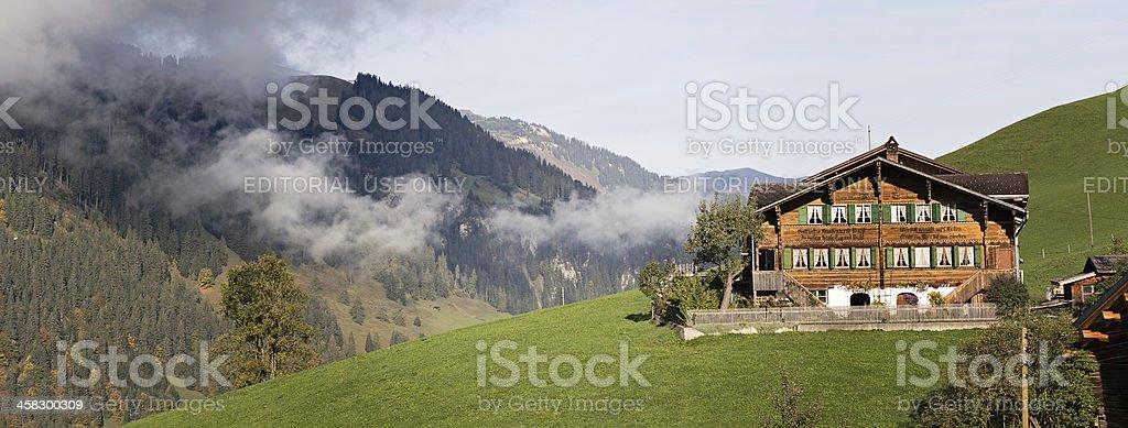 Bernese Oberland Panorama featuring Swiss Farm royalty-free stock photo
