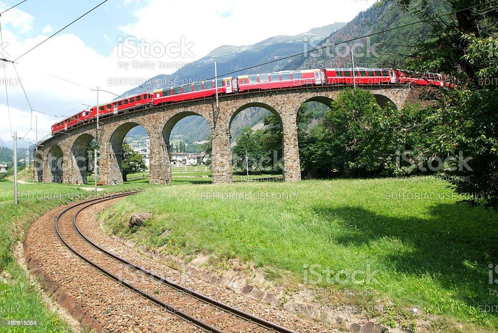Bernina Express Train at Brusio on the Swiss alps stock photo