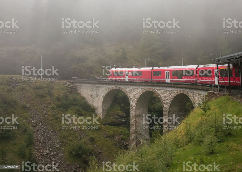 Bernina Express train in the fog, Switzerland stock photo