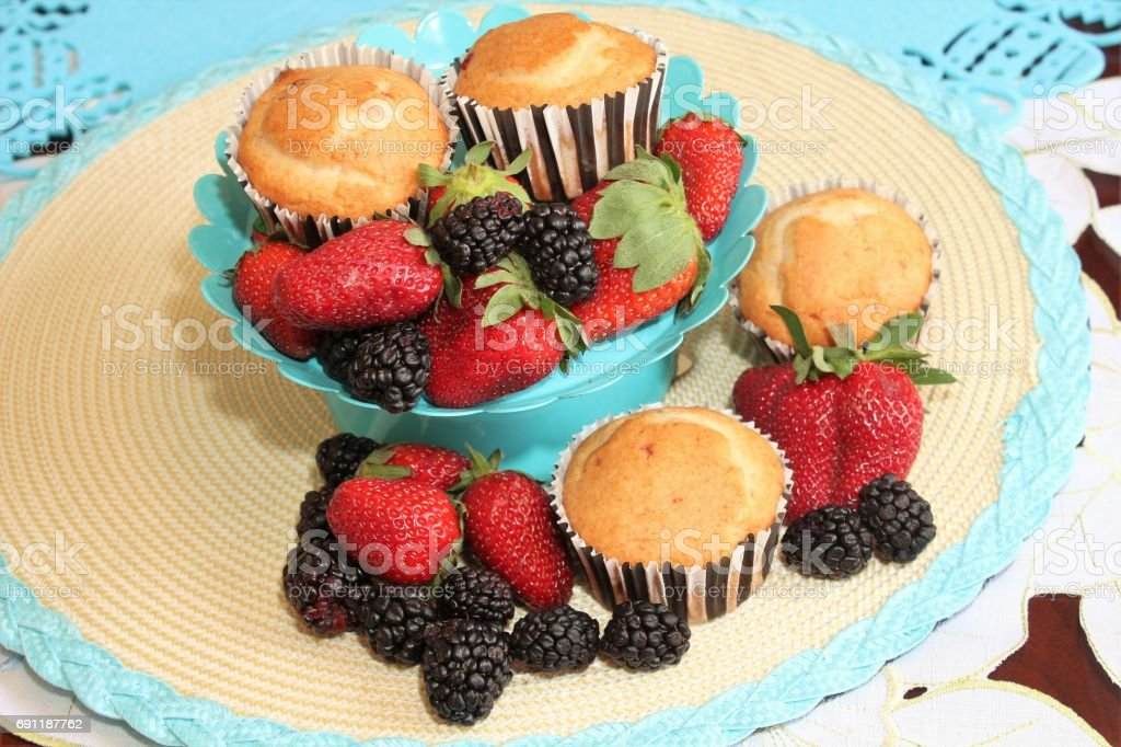 Berries and muffins stock photo