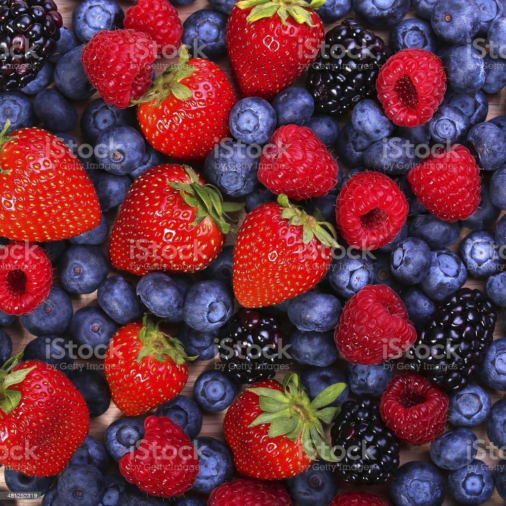 Berries Background. Strawberries, Blueberry, Raspberries, Blackberry. stock photo