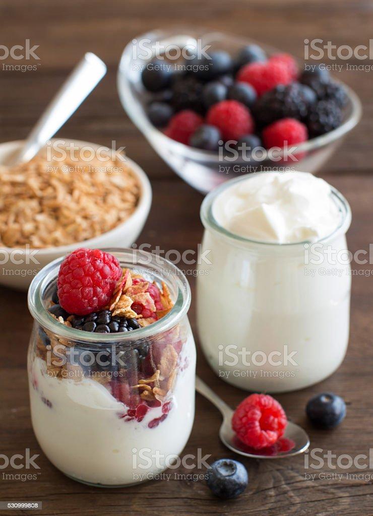Berries, flakes and fresh greek yogurt stock photo