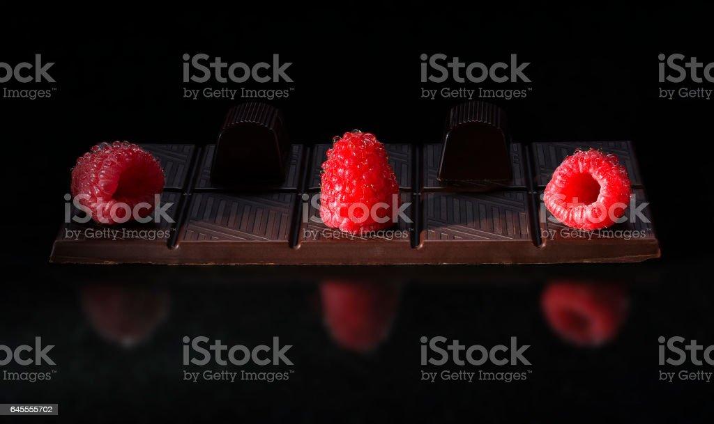 Berries fresh ripe raspberry lie on a chocolate bar stock photo
